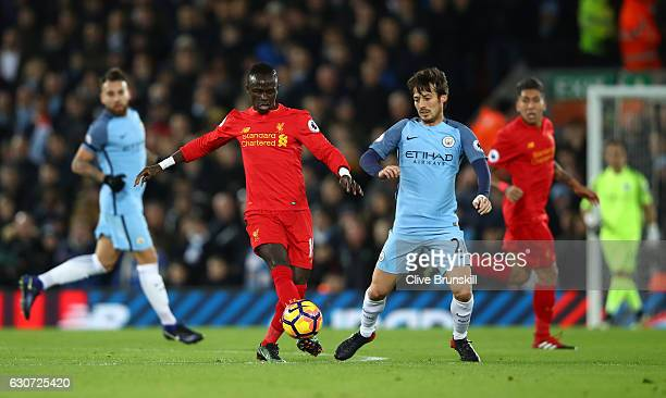Sadio Mane of Liverpool is closed down by David Silva of Manchester City during the Premier League match between Liverpool and Manchester City at...