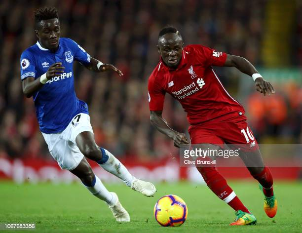 Sadio Mane of Liverpool is closed down by Idrissa Gueye of Everton during the Premier League match between Liverpool FC and Everton FC at Anfield on...