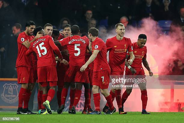 Sadio Mane of Liverpool is congratulated by his teammates after scoring his side's opening goal during the Premier League match between Everton and...