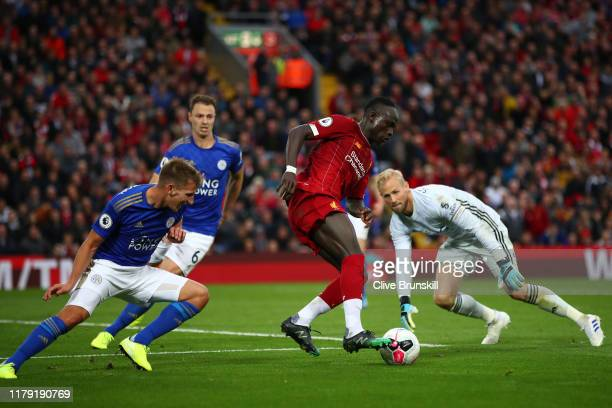 Sadio Mane of Liverpool is fouled by Marc Albrighton of Leicester City and a penalty is later awarded during the Premier League match between...