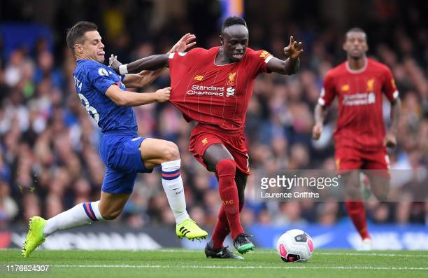 Sadio Mane of Liverpool is held back by Cesar Azpilicueta of Chelsea during the Premier League match between Chelsea FC and Liverpool FC at Stamford...