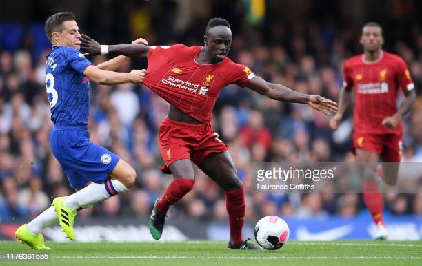 Sadio Mane of Liverpool is tackled by Cesar Azpilicueta of Chelsea during the Premier League match between Chelsea FC and Liverpool FC at Stamford...