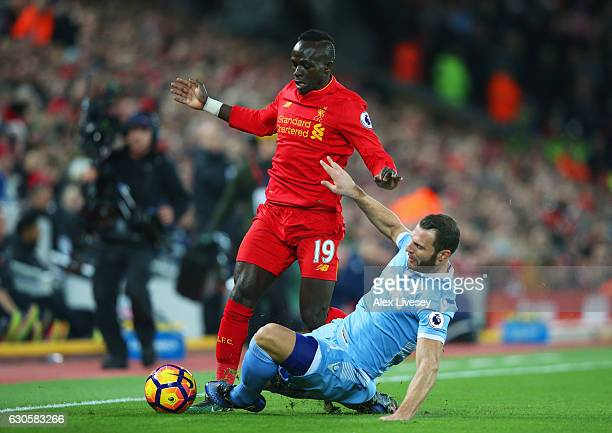 Sadio Mane of Liverpool is tackled by Erik Pieters of Stoke City during the Premier League match between Liverpool and Stoke City at Anfield on...