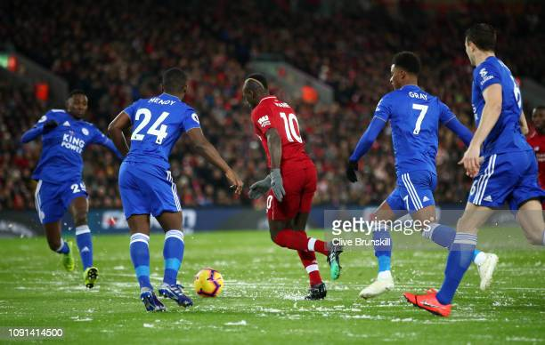 Sadio Mane of Liverpool is watched by the Leicester City defence as he scores his team's first goal during the Premier League match between Liverpool...