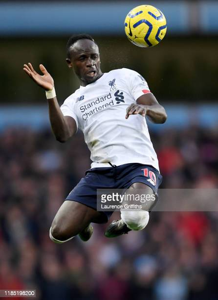 Sadio Mane of Liverpool jumps to head the ball during the Premier League match between Aston Villa and Liverpool FC at Villa Park on November 02,...