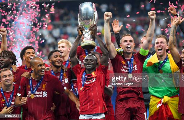 Sadio Mane of Liverpool lifts the UEFA Super Cup trophy as Liverpool celebrate victory following the UEFA Super Cup match between Liverpool and...