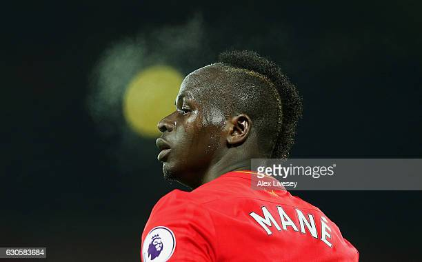 Sadio Mane of Liverpool looks on during the Premier League match between Liverpool and Stoke City at Anfield on December 27 2016 in Liverpool England