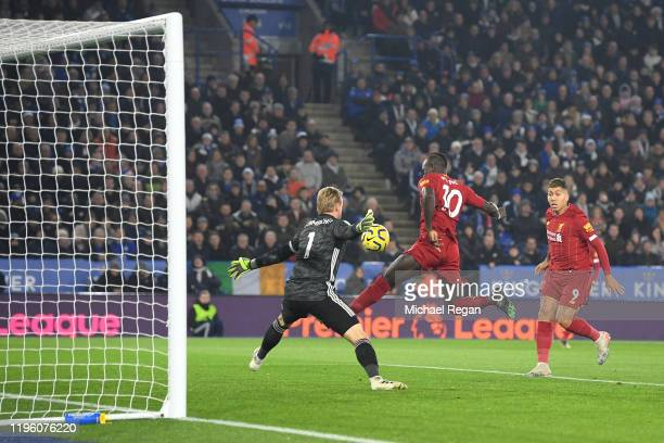 Sadio Mane of Liverpool misses a chance under pressure from Kasper Schmeichel of Leicester City during the Premier League match between Leicester...