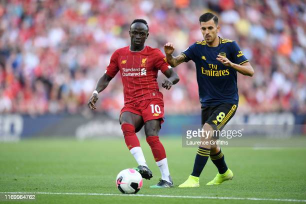 Sadio Mane of Liverpool passes the ball during the Premier League match between Liverpool FC and Arsenal FC at Anfield on August 24 2019 in Liverpool...