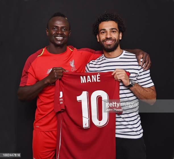 Sadio Mane of Liverpool poses with the new number 10 shirt with Mohamed Salah at Melwood Training Ground on July 20 2018 in Liverpool England