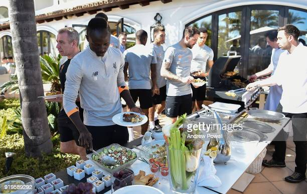 Sadio Mane of Liverpool preparing lunch after a training session at Marbella Football Center on February 17 2018 in Marbella Spain