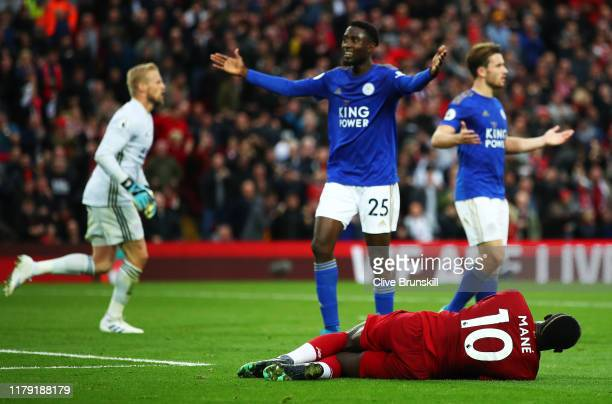 Sadio Mane of Liverpool reacts to being fouled by Marc Albrighton of Leicester City during the Premier League match between Liverpool FC and...