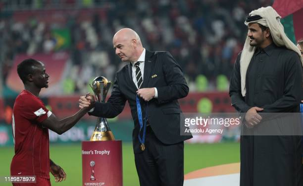 Sadio Mane of Liverpool receives gold medal from President of FIFA Gianni Infantino and Sheikh Joaan bin Hamad bin Khalifa AlThani during the cup...
