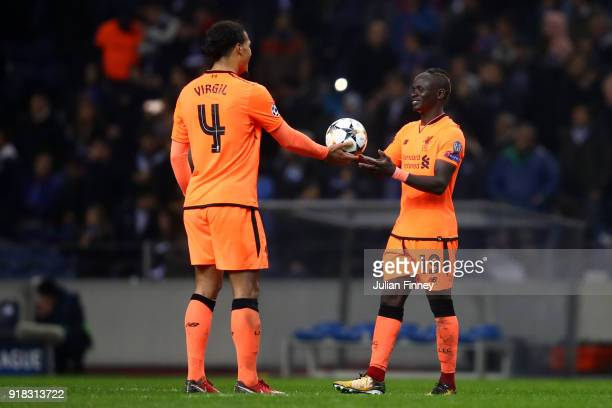 Sadio Mane of Liverpool receives the match ball from Virgil van Dijk of Liverpool after scoring hatrick after the UEFA Champions League Round of 16...