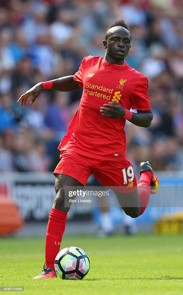 Sadio Mane of Liverpool runs with the ball during a pre-season friendly between Wigan Athletic and Liverpool at JJB Stadium on July 17, 2016 in Wigan, England.