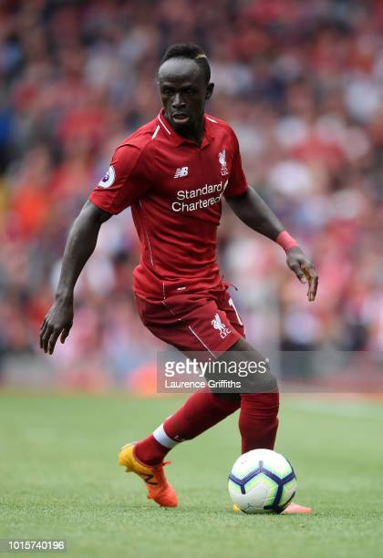 Sadio Mane of Liverpool runs with the ball during the Premier League match between Liverpool FC and West Ham United at Anfield on August 12 2018 in...
