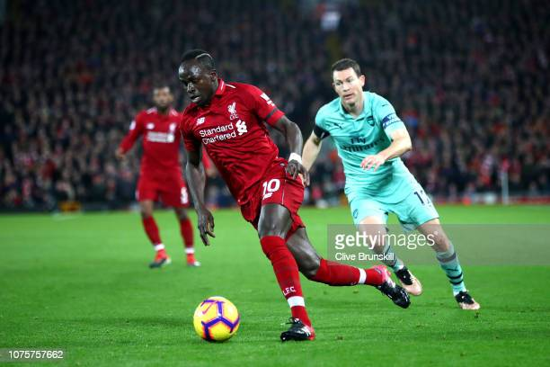 Sadio Mane of Liverpool runs with the ball during the Premier League match between Liverpool FC and Arsenal FC at Anfield on December 29 2018 in...