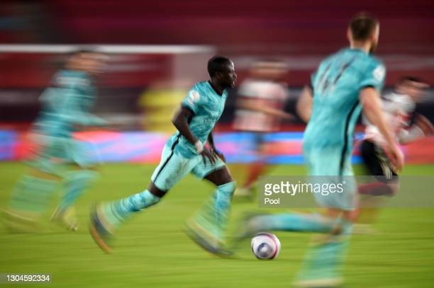 Sadio Mane of Liverpool runs with the ball during the Premier League match between Sheffield United and Liverpool at Bramall Lane on February 28,...