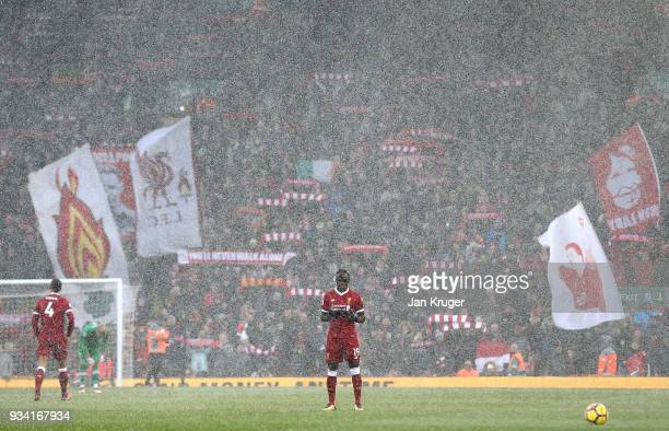 Sadio Mane of Liverpool says a prayer ahead of kick off during the Premier League match between Liverpool and Watford at Anfield on March 17 2018 in...