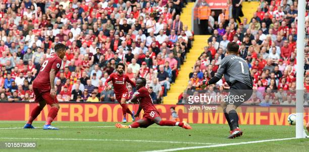 Sadio Mane of Liverpool scores a goal during the end of the Premier League match between Liverpool FC and West Ham United at Anfield on August 12...