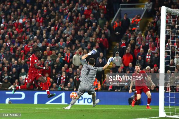 Sadio Mane of Liverpool scores a goal past Iker Casillas of FC Porto but it is latter disallowed during the UEFA Champions League Quarter Final first...