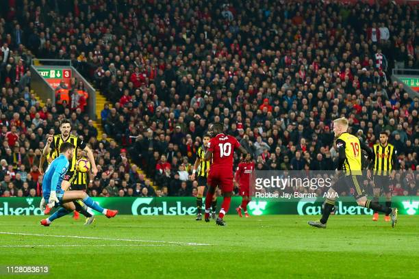 Sadio Mane of Liverpool scores a goal to make it 20 during the Premier League match between Liverpool FC and Watford FC at Anfield on February 27...