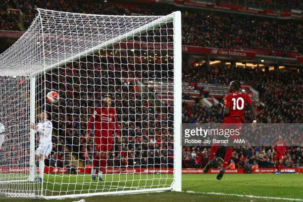 Sadio Mane of Liverpool scores a goal to make it 3-2 during the Premier League match between Liverpool FC and West Ham United at Anfield on February...