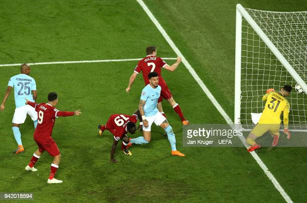 Sadio Mane of Liverpool scores his sides 3rd goal during the UEFA Champions League quarter final leg one match between Liverpool and Manchester City...
