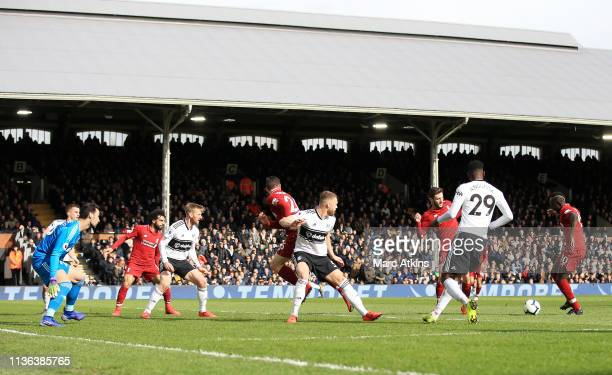 Sadio Mane of Liverpool scores his sides first goal during the Premier League match between Fulham FC and Liverpool FC at Craven Cottage on March 17...