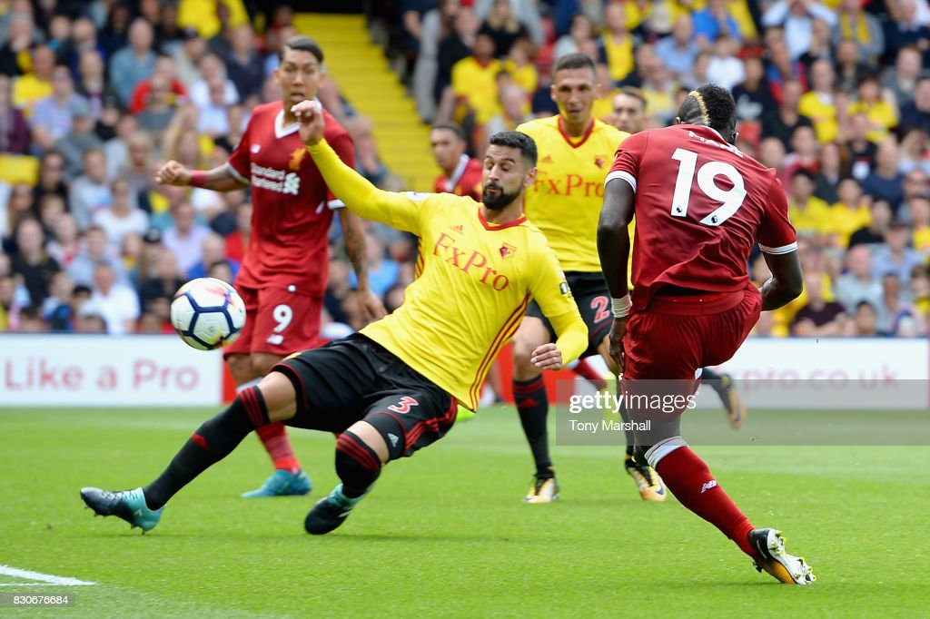 Sadio Mane of Liverpool scores his sides first goal during the Premier League match between Watford and Liverpool at Vicarage Road on August 12, 2017 in Watford, England.