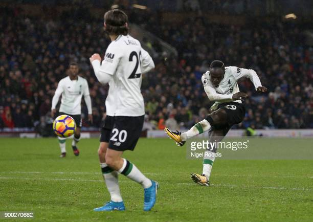 Sadio Mane of Liverpool scores his sides first goal during the Premier League match between Burnley and Liverpool at Turf Moor on January 1 2018 in...