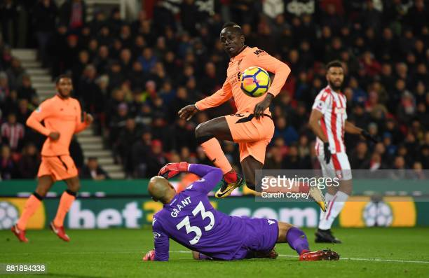 Sadio Mane of Liverpool scores his sides first goal past Lee Grant of Stoke City during the Premier League match between Stoke City and Liverpool at...