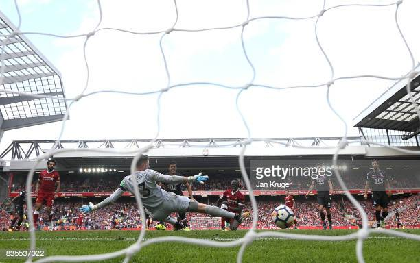 Sadio Mane of Liverpool scores his sides first goal past Wayne Hennessey of Crystal Palace during the Premier League match between Liverpool and...