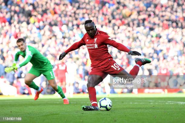 Sadio Mane of Liverpool scores his sides fourth goal during the Premier League match between Liverpool FC and Burnley FC at Anfield on March 10 2019...
