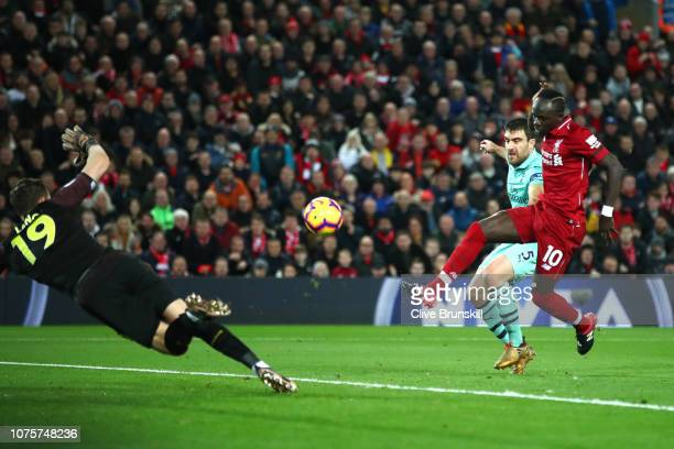 Sadio Mane of Liverpool scores his sides third goal during the Premier League match between Liverpool FC and Arsenal FC at Anfield on December 29...