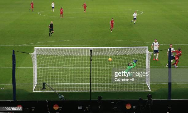 Sadio Mane of Liverpool scores his sides third goal during the Premier League match between Tottenham Hotspur and Liverpool at Tottenham Hotspur...