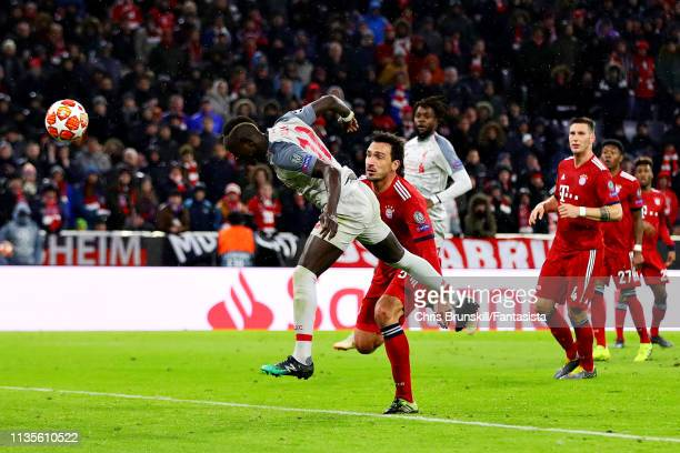 Sadio Mane of Liverpool scores his side's third goal during the UEFA Champions League Round of 16 Second Leg match between FC Bayern Muenchen and...