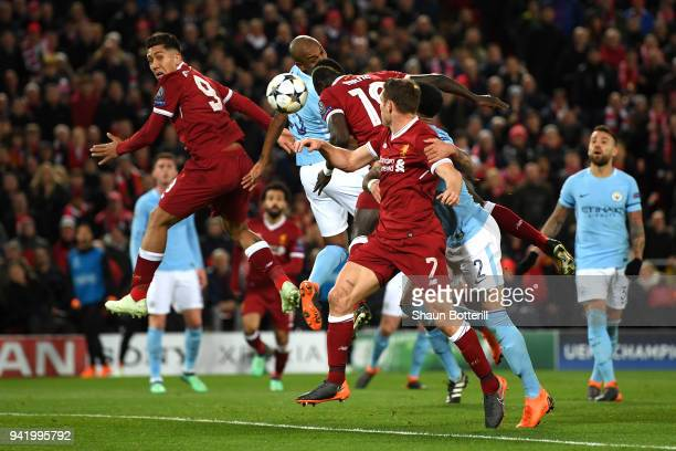 Sadio Mane of Liverpool scores his sides third goal during the UEFA Champions League Quarter Final Leg One match between Liverpool and Manchester...