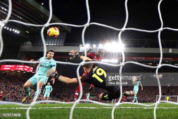 Sadio Mane of Liverpool scores his sides third goal past Bernd Leno of Arsenal during the Premier League match between Liverpool FC and Arsenal FC at...