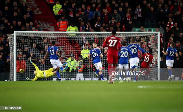 Sadio Mane of Liverpool scores his teams 4th goal during the Premier League match between Liverpool FC and Everton FC at Anfield on December 04 2019...