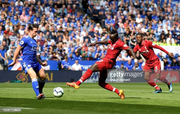 Sadio Mane of Liverpool scores his team's first goal during the Premier League match between Leicester City and Liverpool FC at The King Power...