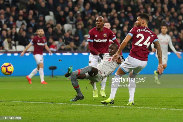 Sadio Mane of Liverpool scores his team's first goal during the Premier League match between West Ham United and Liverpool FC at London Stadium on...