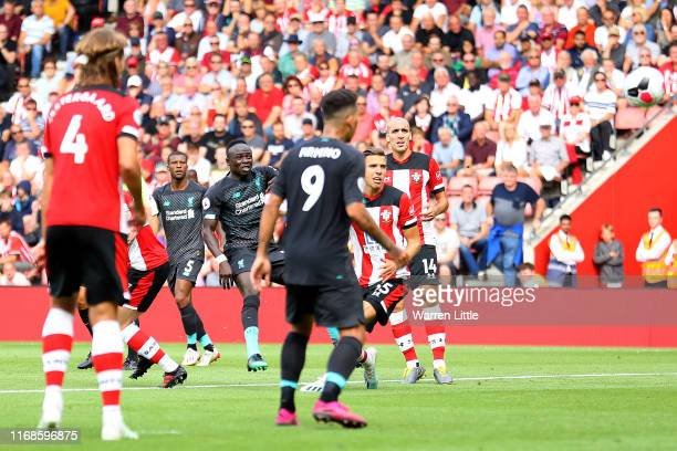Sadio Mane of Liverpool scores his team's first goal during the Premier League match between Southampton FC and Liverpool FC at St Mary's Stadium on...
