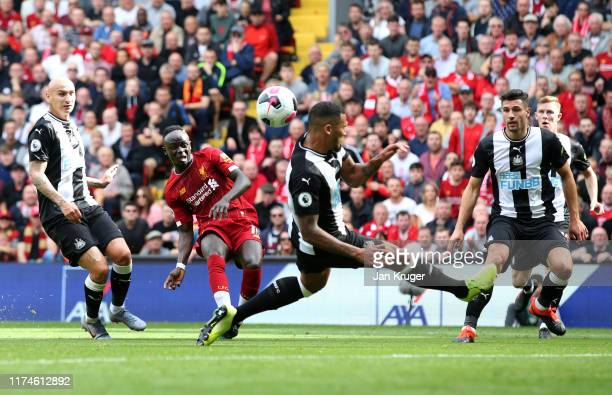 Sadio Mane of Liverpool scores his team's first goal during the Premier League match between Liverpool FC and Newcastle United at Anfield on...