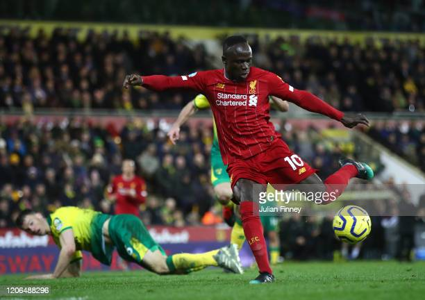 Sadio Mane of Liverpool scores his team's first goal during the Premier League match between Norwich City and Liverpool FC at Carrow Road on February...