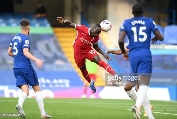 Sadio Mane of Liverpool scores his team's first goal during the Premier League match between Chelsea and Liverpool at Stamford Bridge on September...