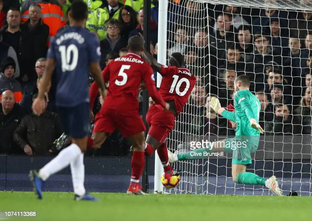 Sadio Mane of Liverpool scores his team's first goal past David De Gea of Manchester United during the Premier League match between Liverpool FC and...