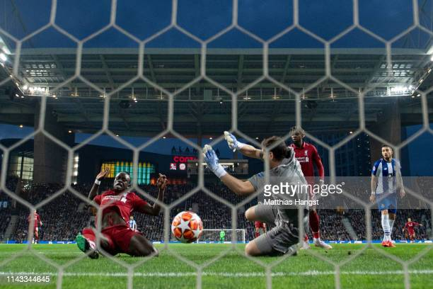 Sadio Mane of Liverpool scores his team's first goal past Iker Casillas of FC Porto during the UEFA Champions League Quarter Final second leg match...