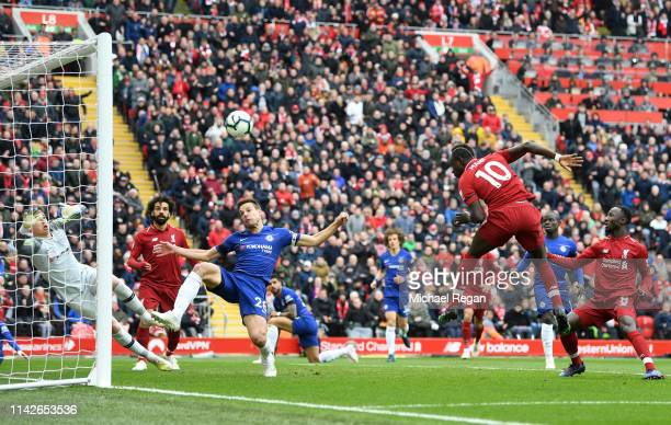 Sadio Mane of Liverpool scores his team's first goal past Kepa Arrizabalaga of Chelsea during the Premier League match between Liverpool FC and...
