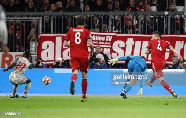 Sadio Mane of Liverpool scores his team's first goal past Manuel Neuer of Bayern Munich during the UEFA Champions League Round of 16 Second Leg match...